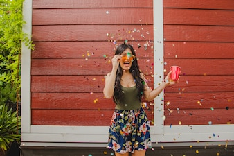 Girl laughing with confetti