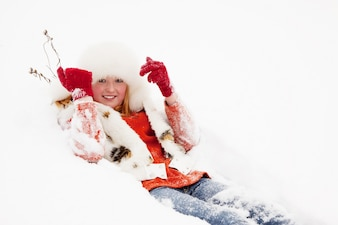 Girl lying on  snow