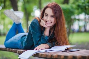 Girl lying on table smiling