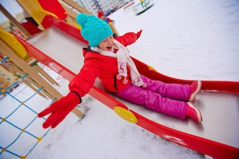Girl playing on the slide