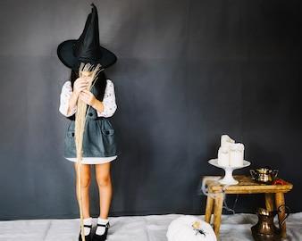 Girl playing with broom