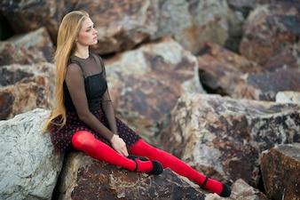 Girl posing over the rocks