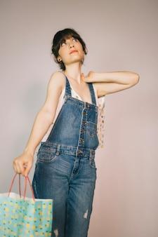 Girl posing with shopping bag
