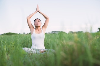 Girl practicing yoga sitting