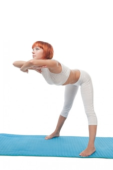 Girl practicing yogatic asana