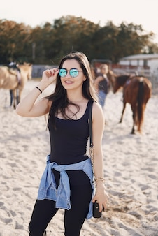 Girl preparing to ride a horse