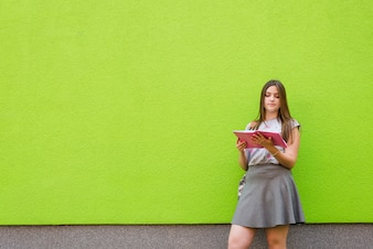 Girl readingbook outside