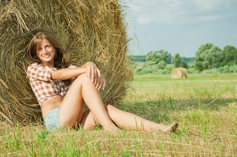 Girl  resting on straw bale