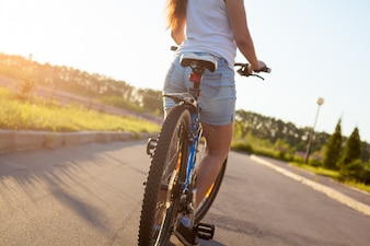 Girl riding a bike with jeans