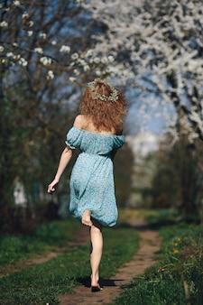 Girl running across the forest