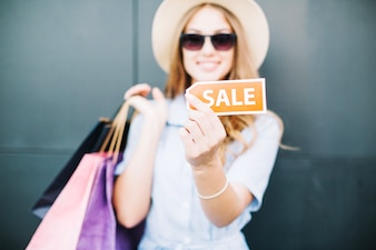 Girl showing sale sign