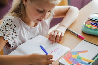 Girl sitting at desk writing