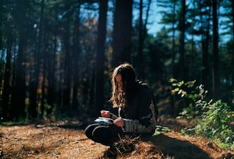 Girl sitting in the woods