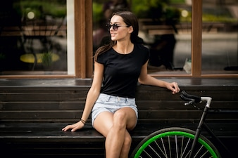 Girl sitting on a bench