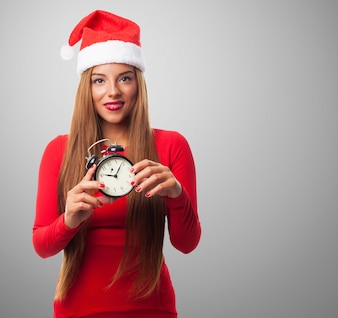 Girl smiling with a clock in her hands