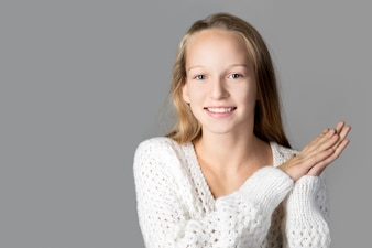 Girl smiling with hands clasped