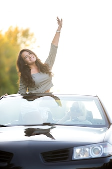 Girl standing in convertible