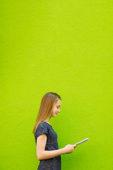 Girl standing with notebook