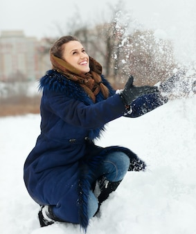 Girl throwing up snowflakes