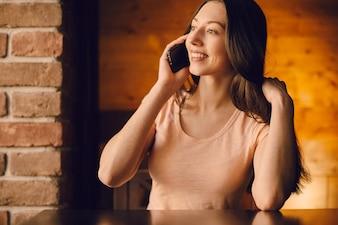 Girl touching her hair while talking