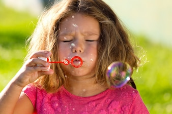Girl trying to blow bubbles