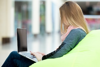 Girl typing on a laptop