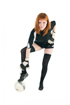 Girl wearing football outfit with ball