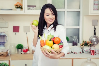 Girl with a bowl of vegetables