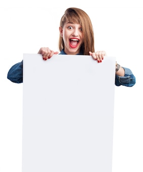 Girl with casual hairstyle holding a white sign