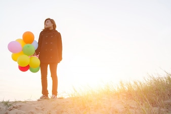 Girl with colorful balloon
