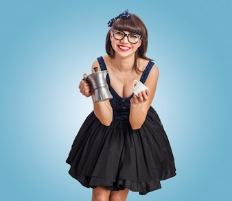 Girl with glasses and coffee maker