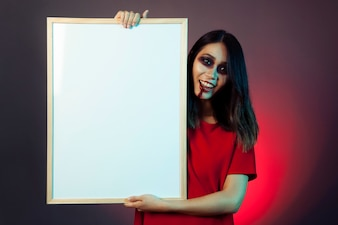 Girl with halloween makeup holding whiteboard