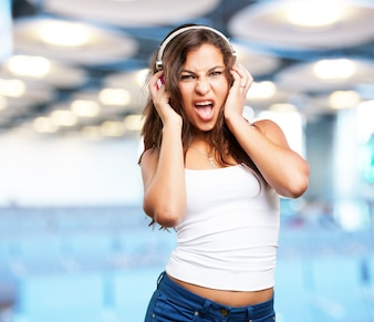Girl with headphones singing