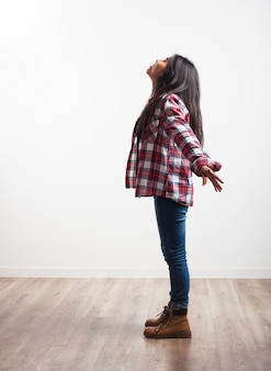 Girl with open arms and looking at the ceiling