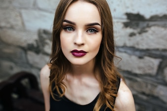 Girl with straight hair and lips painted red