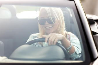 Girl with sunglasses driving