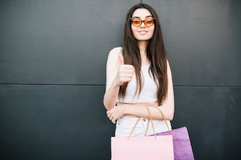 Girl with super gesture after shopping