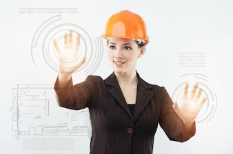 Girl with worker hat and touch screen