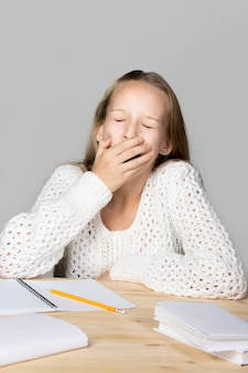Girl yawning while studying