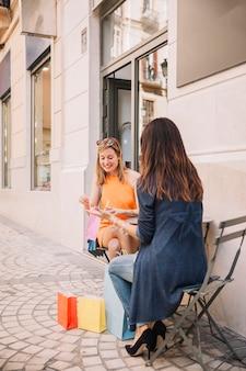 Girls in coffee shop outside