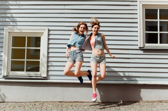 Girls in summer clothes jumping