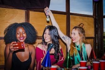 Girls joking at party
