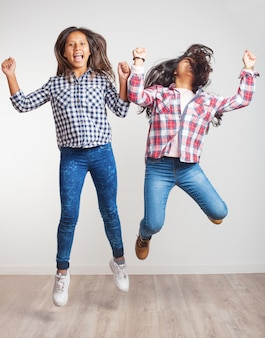Girls jumping and smiling