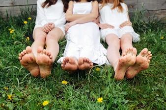 Girls sitting on the grass