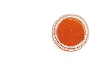 Glass jar with orange marmalade
