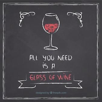 Glass of wine on blackboard