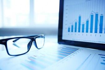Glasses and digital tablet on desk