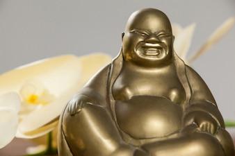 Gold painted laughing buddha figurine
