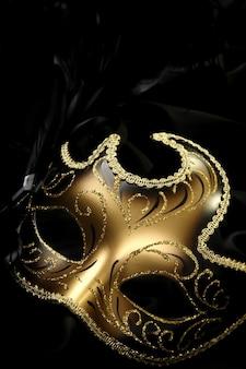 Golden carnival mask on black background