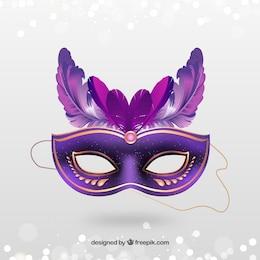 Golden carnival mask with pink feathers